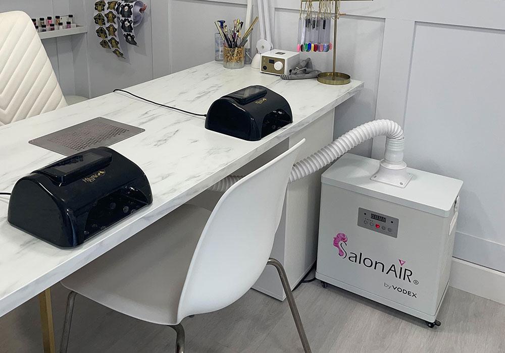 Vodex SalonAIR under Nicolette's desk