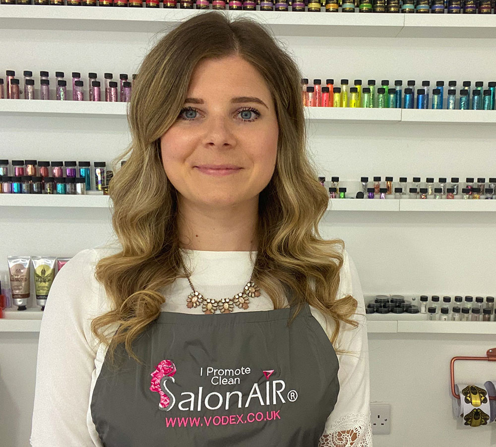 Nicolette in her Salon with a SalonAIR apron