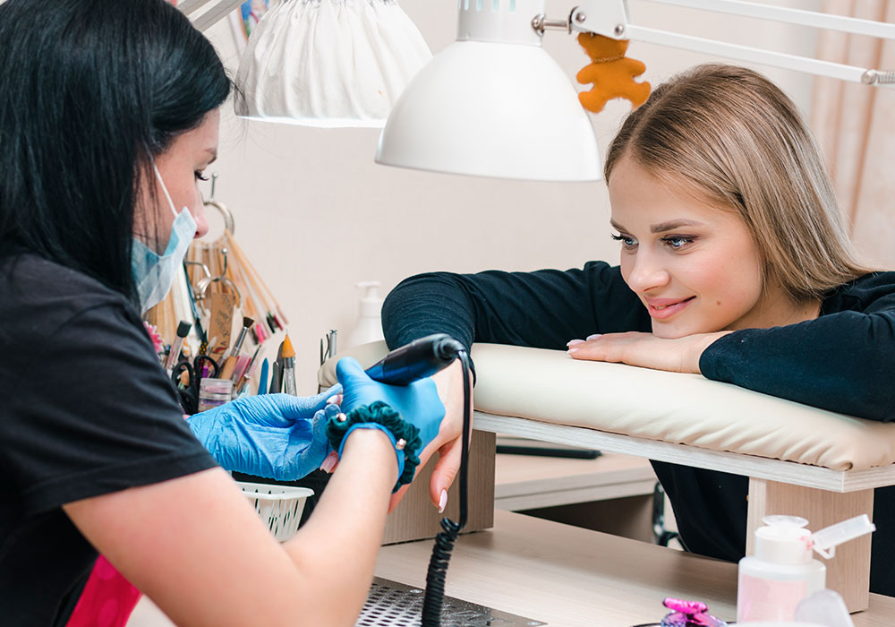 young lady getting her nails done in a salon