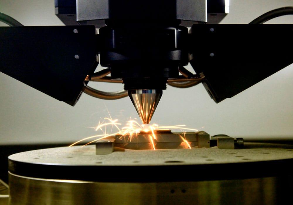 Close up of 3d printer printing a metal piece