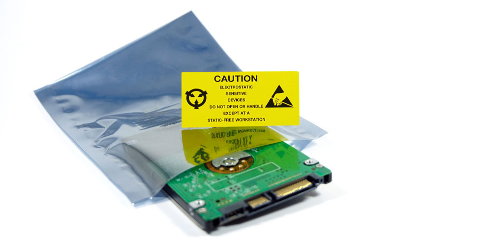 computer component in anti-static packaging with a yellow warning sticker for ESD