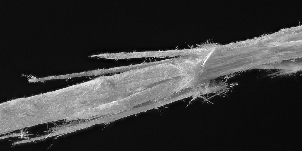 Why is asbestos dangerous? - Close-up of asbestos crystals