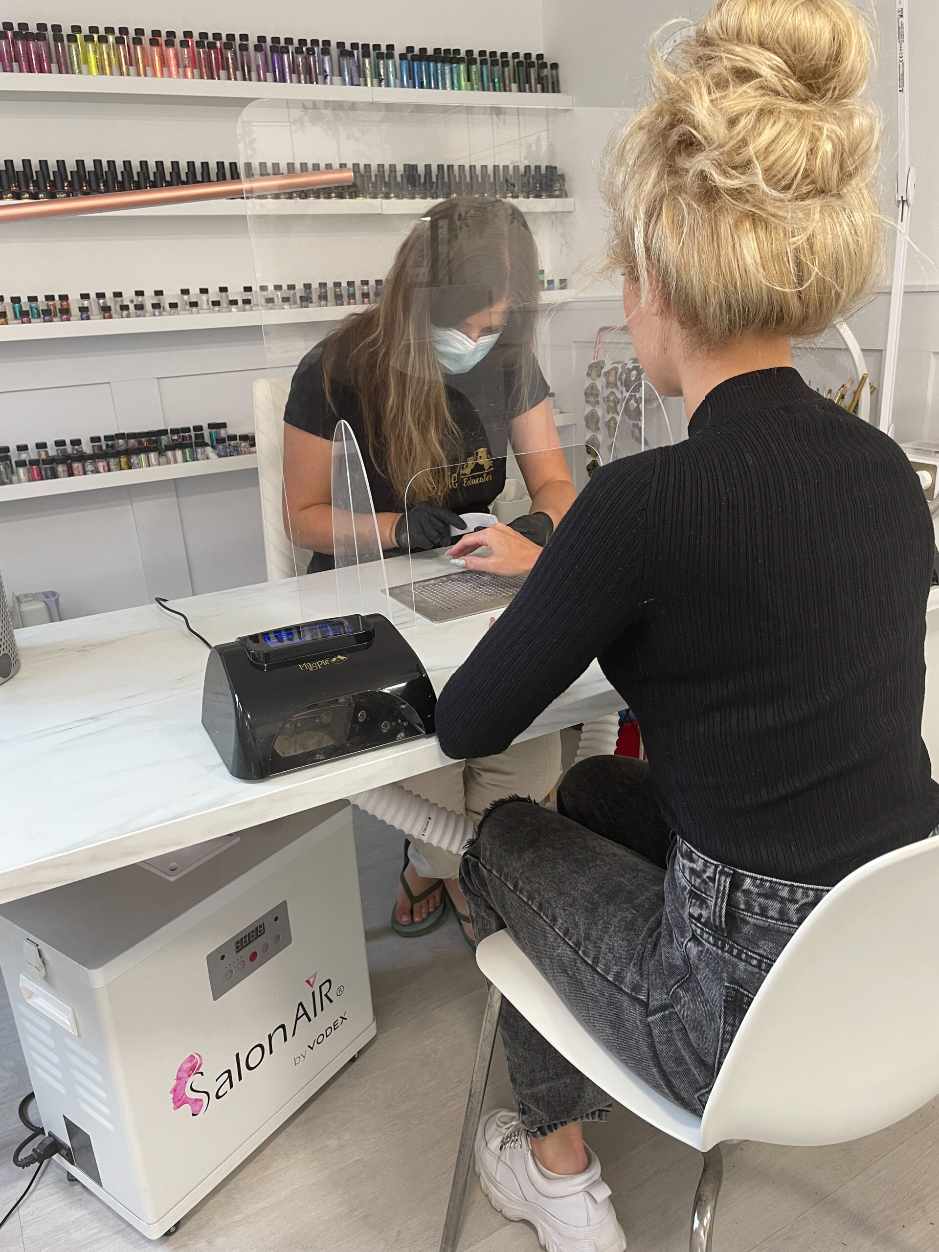 Lady having nails done in Salon with SalonAir extraction system